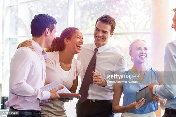 Business associates relaxing together after work