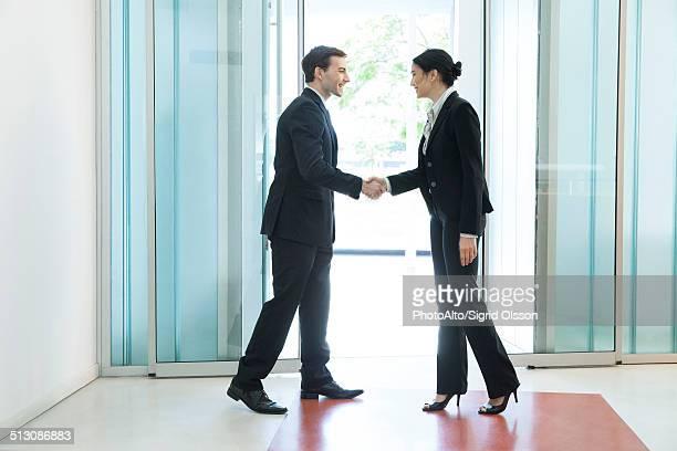 Business associates shaking hands