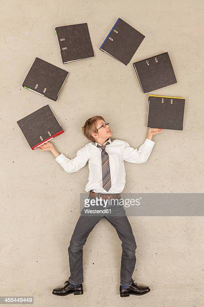 Business boy juggling with files