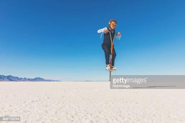 Business Boy Jumping on Pogo Stick