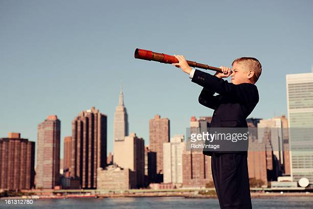Business Boy Looking Through Telescope in New York City