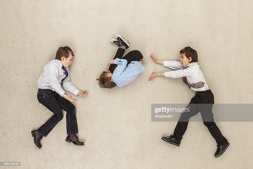 Business boys against beige background