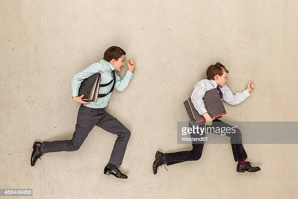 Business boys running in office