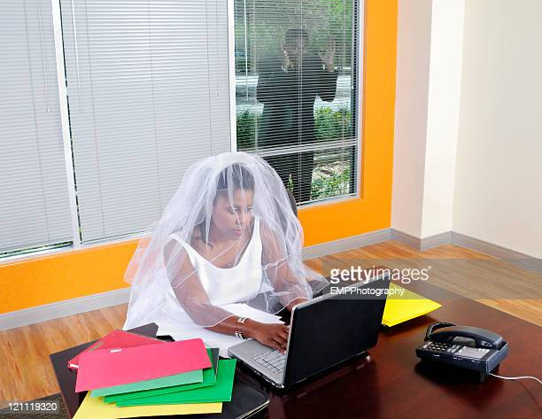 Business Bride Working on  a Laptop Groom Outdoors looking In
