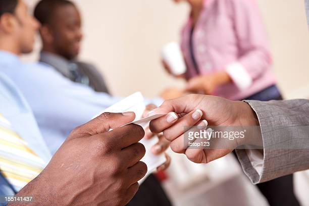Business card exchange. People. Hands. Multi-ethnic group. Professionals.