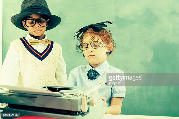 Business:  Child secretary and her boss at desk with typewriter.