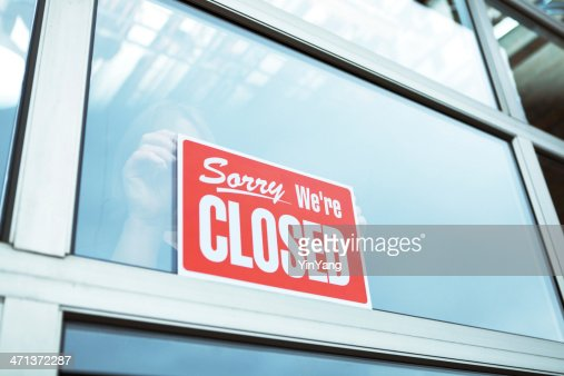 Business Closing with 'Sorry We're Closed' Sign Hz