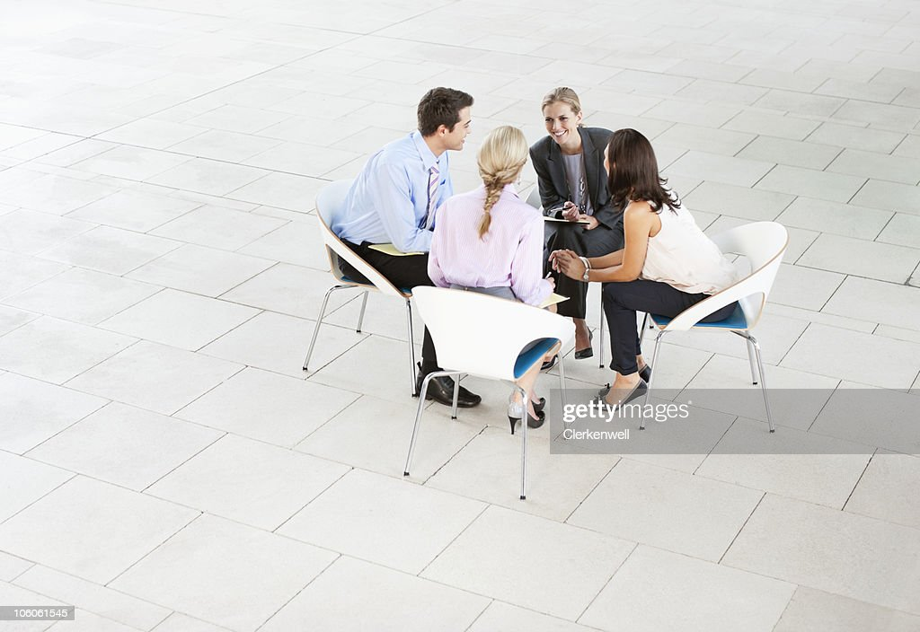 Business colleague discussing with each other : Stock Photo