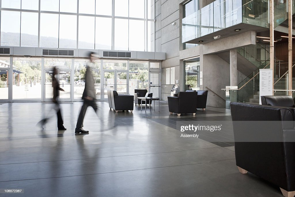 business colleagues blurred walking through office