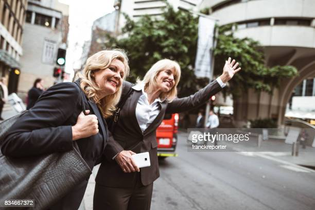 business colleagues calling a taxi in the city