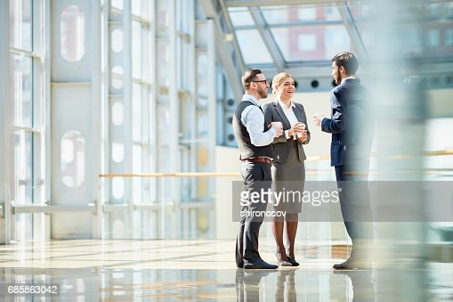 Business Colleagues Chatting at Coffee Break : Stock Photo