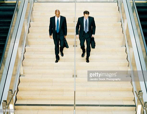 Business colleagues descending a flight of stairs