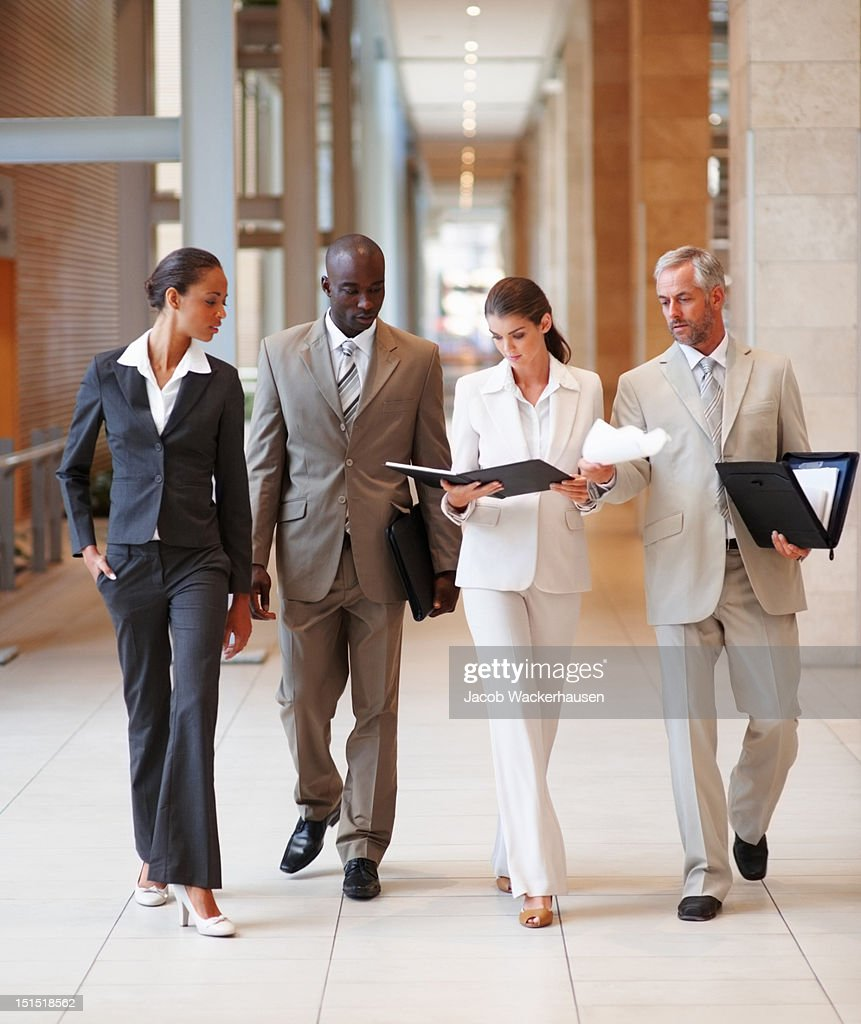 Business colleagues discussing documents in hands
