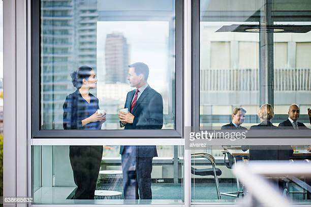 Business colleagues discussing during coffee break