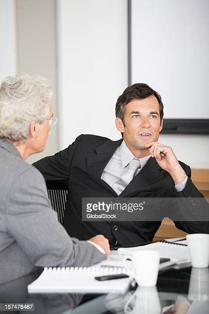 Business colleagues discussing in a meeting