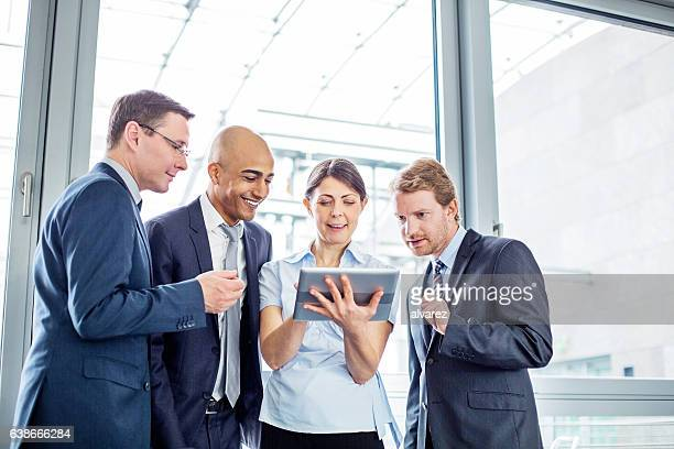 Business colleagues discussing over digital table