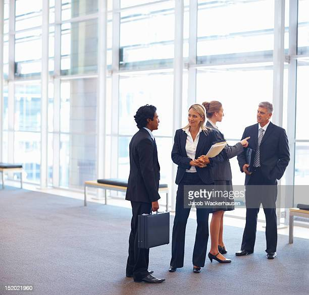 Business colleagues discussing with each other