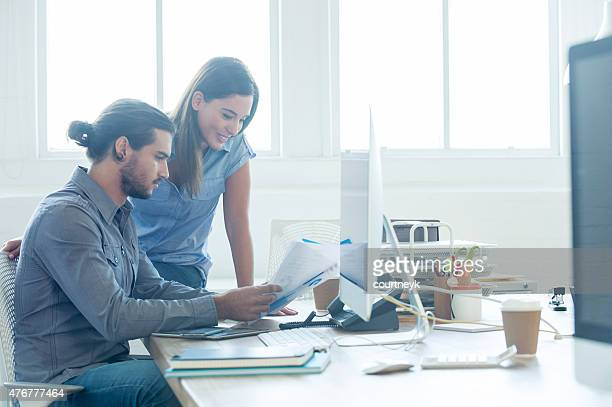 Business colleagues going over a report together.