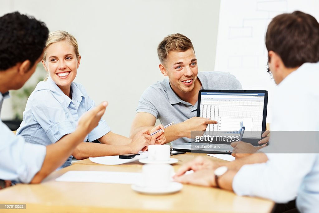 Business colleagues happy about the new strategy plan : Stock Photo