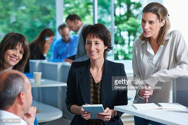 Business colleagues having informal meeting in office