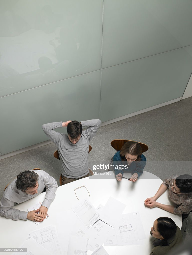 Business colleagues having meeting in board room, elevated view : Stock Photo