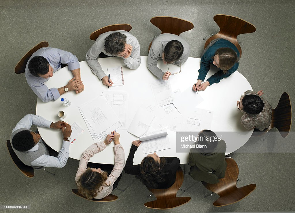 Business colleagues having meeting in board room, overhead view : Stock Photo