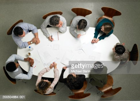 Business colleagues having meeting in board room, overhead view : Stockfoto