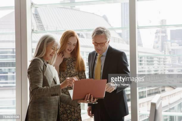 Business colleagues having meeting, London, UK