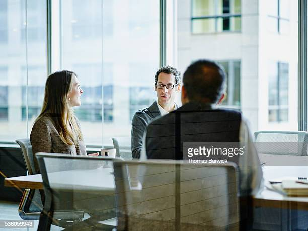 Business colleagues in discussion during meeting