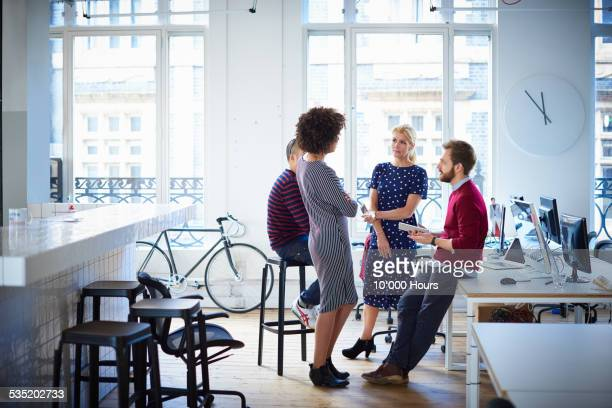 Business colleagues in informal meeting in office