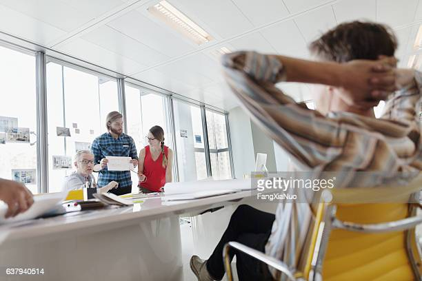 Business colleagues interacting in large conference room