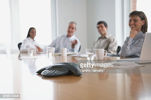 Business colleagues sitting at conference table : Stock Photo