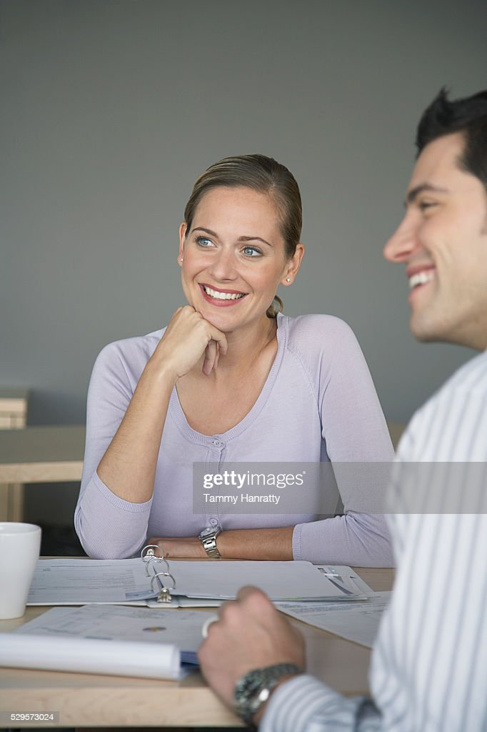 Business colleagues sitting together : Stockfoto