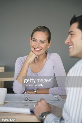 Business colleagues sitting together : Stock Photo