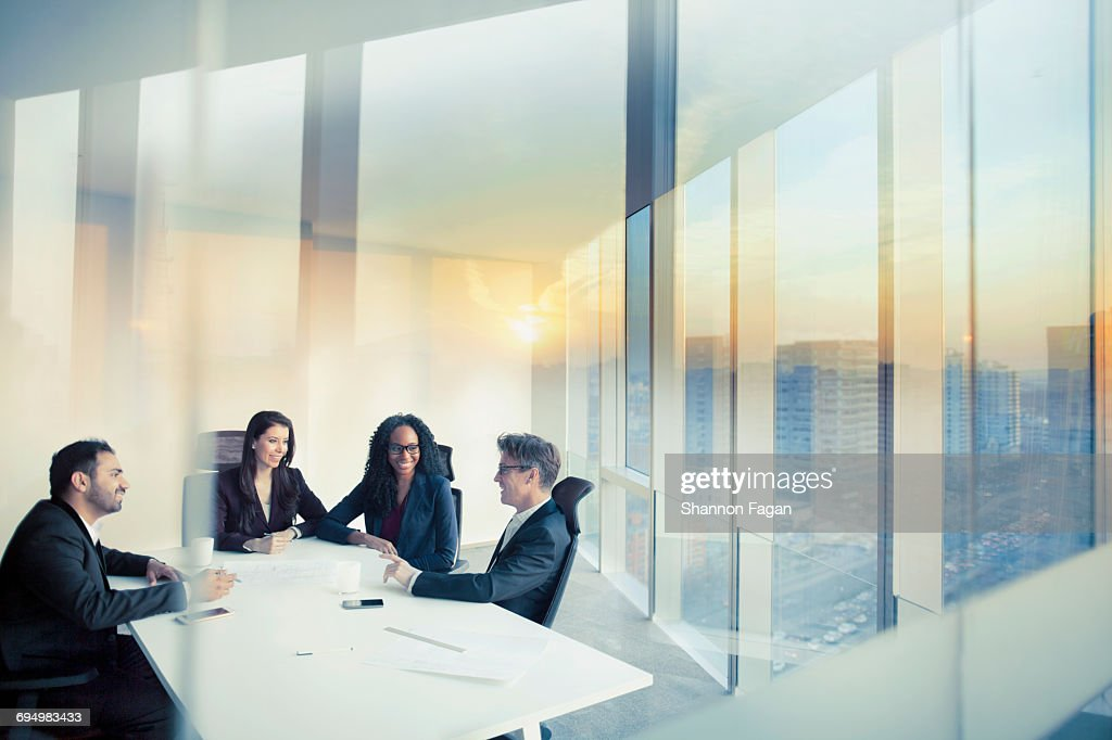 Business colleagues talking in meeting room : Stock Photo