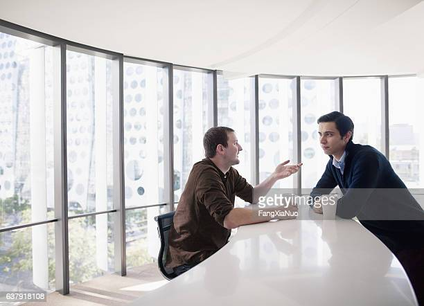 Business colleagues talking together in break room