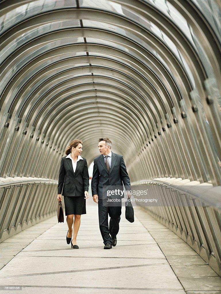 Business colleagues walking in a walkway