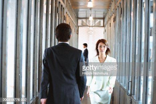 Business colleagues walking in corridor