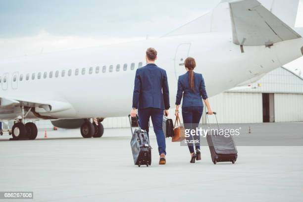 Business colleagues walking on tarmac at the airport