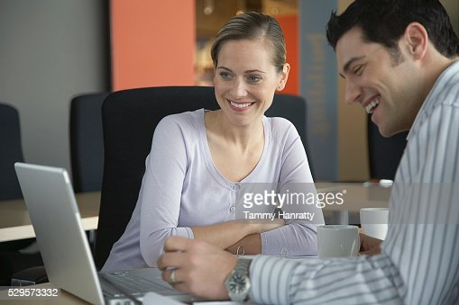 Business colleagues working on laptop : Stock Photo
