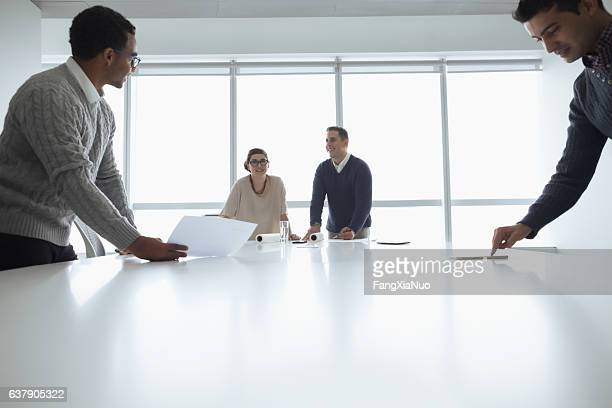 Business colleagues working together in meeting room