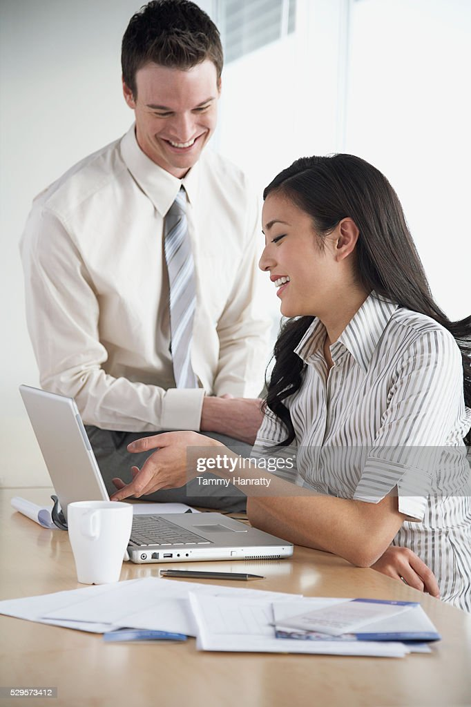 Business colleagues working together : Stock Photo