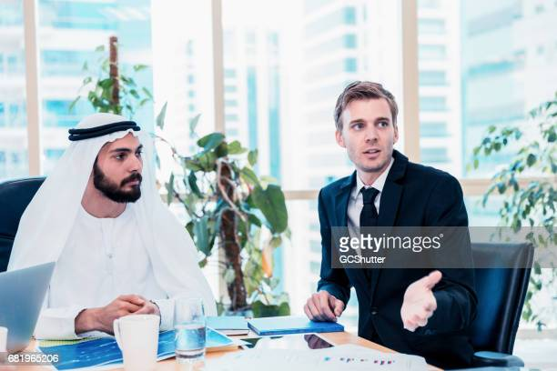 Business Consultant Proposing The Startup Strategy with An Arab Businessman