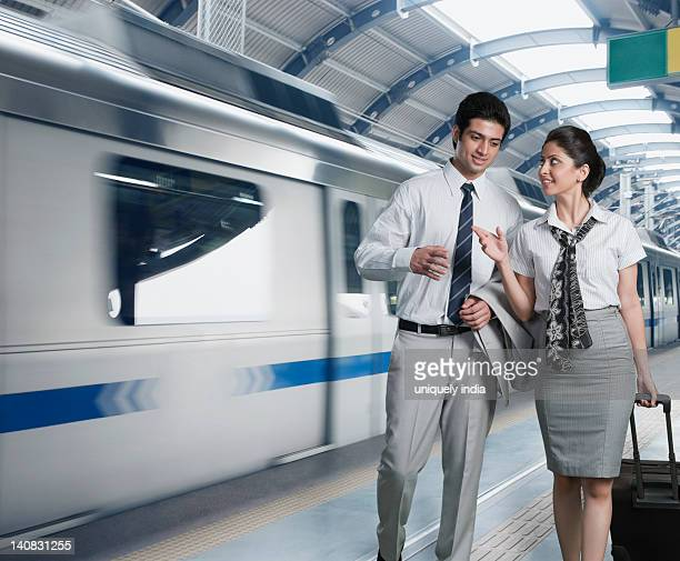 Business couple at a subway station