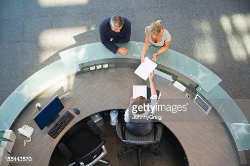 Business Couple At Reception Desk