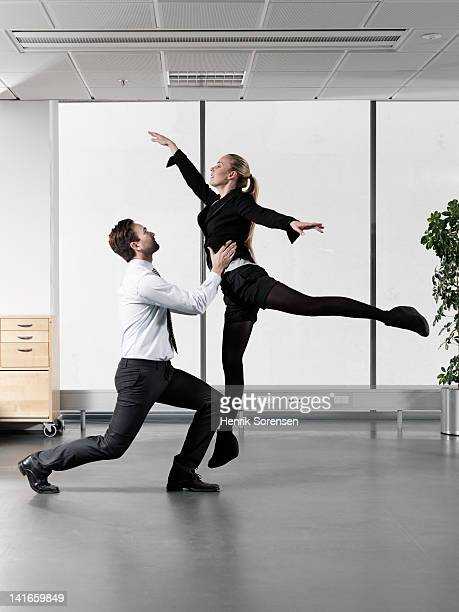 business couple dancing in office