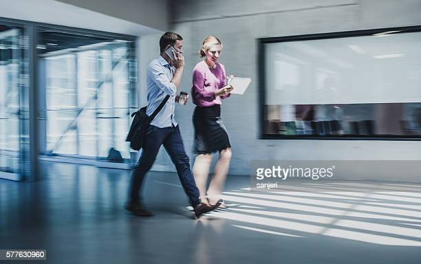 Business Couple Entering the Business Building