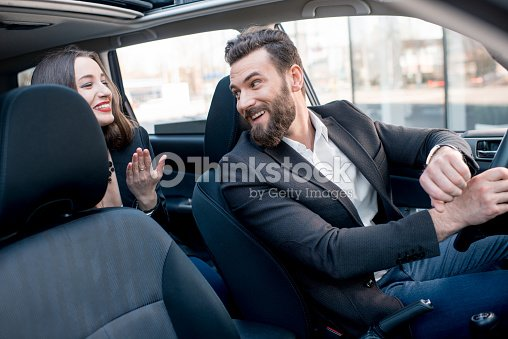 business couple in the car ストックフォト thinkstock