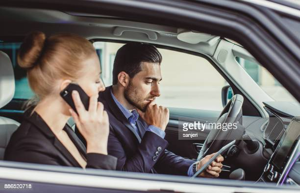 Business Couple in the Car