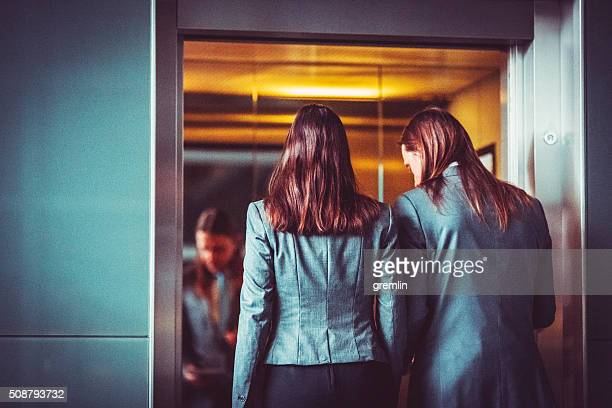 Business couple in the elevator